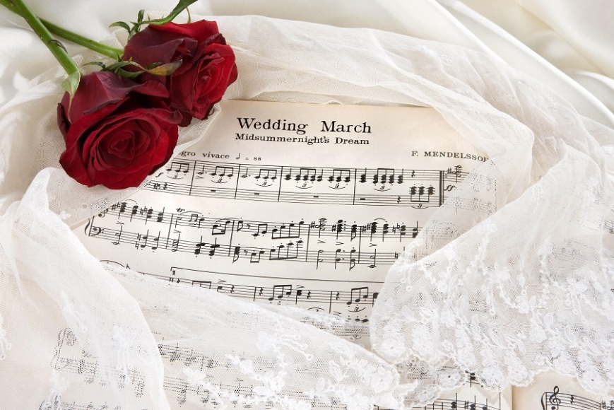 Sheet Music Of The Wedding March With Roses And Bridal Veil